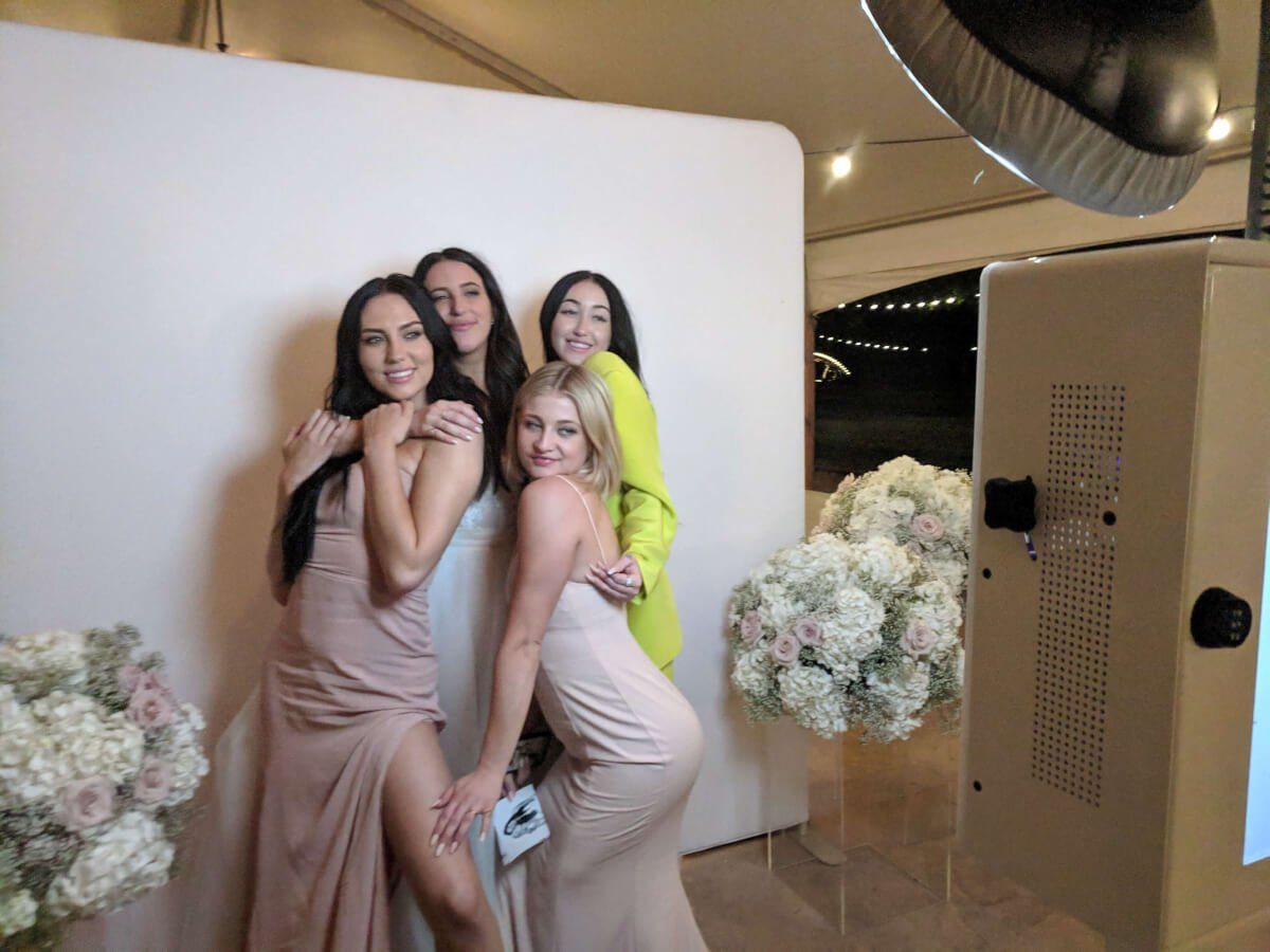 Celebrities posing in the photo booth